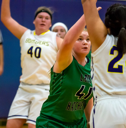 Windsor/Stew-Stras' Madison Everett, center, defends against Brownstown/St. Elmo's Elissa Baron, who attempts to pass to teammate Natalie Oberlink, left.