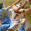 Altamont's Mitchell Stevenson works around the defense of Cumberland's Gabe Hatfill at Altamont.