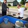 5-22-12<br /> Western HS seniors voluteer to clean up around the town of Russiaville on Tuesday. Daniel Johnson and Garrett Hill scoop up debree from Union Street after the gutters were swept.<br /> KT photo | Tim Bath
