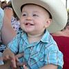 Henry Loy sits on his mom's lap before the C-Bar Rodeo at the Effingham County Fair. Kaitlin Cordes photo