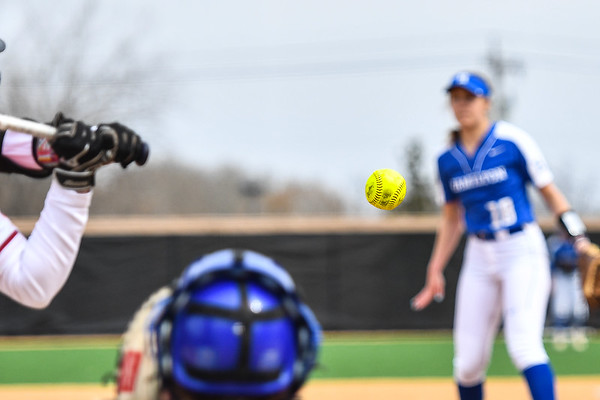 Equipment, Hamilton College catcher Liz Brautigam (5), Hamilton College pitcher Morgan Hartranft (18)<br /> <br /> 4/7/19 11:53:52 AM Wesleyan University v Hamilton College, at Loop Road Softball/Baseball Complex, Hamilton College, Clinton, NY<br /> <br /> Final: Wesleyan 0   Hamilton 1<br /> <br /> Photo by Josh McKee