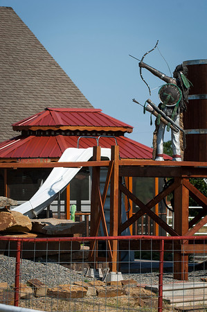 An Indian sculpture shoots an arrow on the water tower above the Old West town Pat and Belienda Garrett have built.