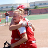 St. Anthony's Maddie Kibler hugs teammate Lucy Fearday during a softball game against Illini Bluffs in the Class 1A state championship game, Wednesday, June 16, 2021, at the Louisville Slugger Sports Complex in Peoria, Ill.