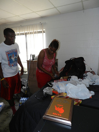 Bacone College freshman Verriel Littleton and his mother, Delta Scott, unpack in his Posey Hall dorm room. Classes at Bacone start Aug. 9.