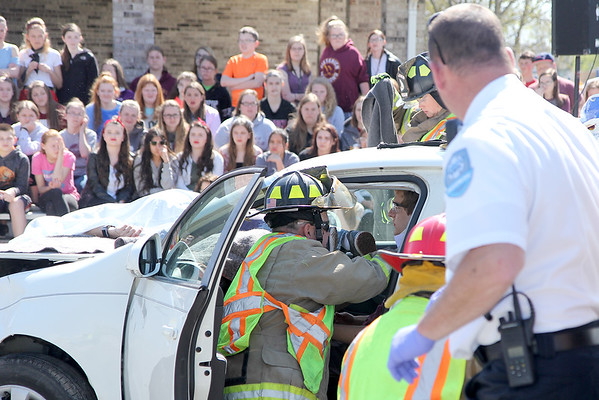 Medical personnel examine Seth Bohnhoff, a junior, who played the drunken driver during a mock accident at the Dieterich School on Tuesday. The event was organized by Dieterich Fire Chief Ross Martin ahead of prom on Friday. Graham Milldrum photo