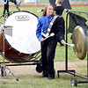 Newton Community High School Marching Eagles band member Alivia Huddleston plays both the bass drum and gong during the Effingham Marching Hearts Invitational band contest on Saturday afternoon. Newton captured the best percussion trophy in the Class 3A schools division. Charles Mills photo