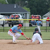Effingham (St. Anthony) shortstop Eli Moore tags out a would-be North Clay baserunner during a baseball game in the Class 1A Sectional 6 Regional Finals on Monday, July 7, 2021, at Evergreen Hollow Park, in Effingham, Illinois. (Alex Wallner/Effingham Daily News)