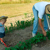 Gavin Haynes, 2, helps Grandpa hoe the garden.<br /> <br /> Submitted by Sarah Haynes.