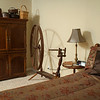 A spinning wheel adds interest to a guest bedroom.