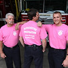 Allegra Boverman/Gloucester Daily Times. The Gloucester Fire Department's personnel are wearing pink t-shirts for the month of October during Breast Cancer Awareness Month. The shirts can be purchased at the Central Fire Station on School Street and cost $15. From left, showing off their shirts are: fire inspector Joe Mountain, Capt. Tom LoGrande and Firefighter Chad Mota.