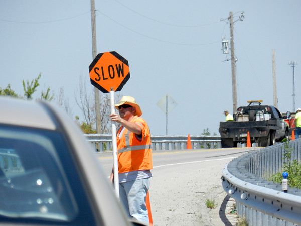A road crew applies a waterproof seal Tuesday afternoon to the bridge over the Verdigris River on Oklahoma 16, between Muskogee and Okay. Workers will do the same to various bridges on Interstate 40, Oklahoma 2, Oklahoma 16 and Oklahoma 51 over the next couple of weeks. Each project could take three to four days, an Oklahoma Department of Transportation spokesman said.