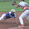 Shelby County Senior Legion's Mason Miller breaks back to first base after a pickoff attempt during a legion baseball game against Lincoln Post 263 on Tuesday, June 29, 2021, at Shelbyville High School, in Shelbyville, Illinois.