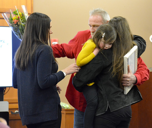 Effingham, Fayette, Clay and Jasper Problem-Solving Court graduate David Windle hugs his two daughters after presenting them with flowers during the problem-solving court graduation ceremony Friday at the Effingham County Government Center. Kaitlin Cordes photo