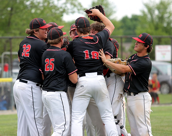 North Clay players celebrate after winning the Class 1A Sectional 6 Regional against Effingham (St. Anthony) on Monday, July 7, 2021, at Evergreen Hollow Park, in Effingham, Illinois. (Alex Wallner/Effingham Daily News)