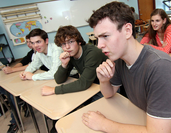 Allegra Boverman/Gloucester Daily Times. From left are Nate Allen, Quenton Hurst, Corey Silver and Oliver Herman, with Sophie Palmer behind them at right, answering quiz questions on Tuesday afternoon at Rockport High School.