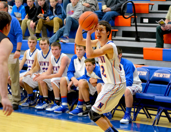 Newton's Collin Harris prepares to shoot a 3-pointer during the Eagles' win over Altamont.
