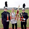 Watseka High School Marching Warriors members from left to right, Drum Major Megan Schippert, Kaleigh Wilson and Drum Major Lauren Pueschell hold their trophies they earned Saturday afternoon during the Effingham Marching Hearts Invitational band contest. Watseka was awarded Grand Champion of the 1A and 2A school divisions and first place in Class 2A competition. Charles Mills photo