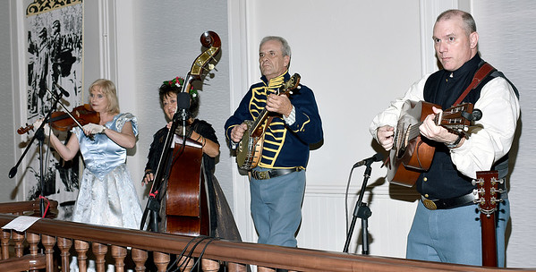 Members of the Effingham based Salt Creek String Band performed period music for the Civil War era Grand Ball held at Saturday night in the old Effingham County Courthouse in downtown Effingham. Members of the band pictured from left, Melody Freeman, Marylynne Toliver, Gratton Toliver and Chris Griffy. Charles Mills photo