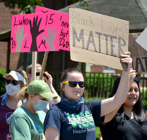 Demonstrators hold up Black Lives Matter signs during a rally held by the Effingham Social Justice Group Saturday.