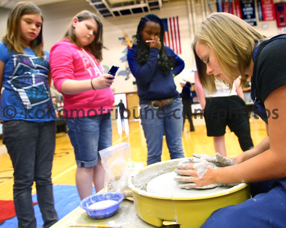 5-18-12<br /> Taylor HS art students put on display and demonstrated their art.<br /> Haileigh Sandefur, Amber Haworth and Jessica Shumaker watch Lindsay Duncan throw clay, demonstrating how it is done.<br /> KT photo   Tim Bath