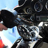 Allegra Boverman/Gloucester Daily Times. Peter Ferazzi of Rockport fills his Harley's gas tank at Richdale Mobil on Friday.
