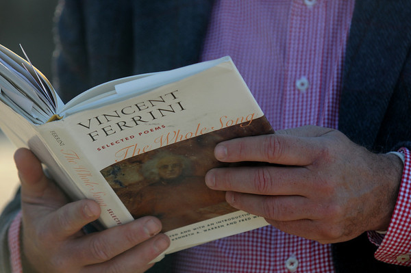 JIm Vaiknoras/Gloucester Times: Walter Skold , The Dead Poet Guy, reads from a book of poems from local poet Vincent Ferrini on Niles Beach in Gloucester Monday morning as part of Dead Poets Remembrance Day.