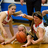 Altamont's Keidron Duckwitz, left, and Leah Mayhaus, right vie for a loose ball against Maroa-Forsyth's Kaylee Robinson, center, at the Okaw Valley Holiday Tournament.
