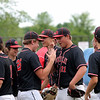 North Clay's Carson Burkett (21) celebrates with Jesse Weidner (25) after winning the Class 1A Sectional 6 Regional against Effingham (St. Anthony) on Monday, July 7, 2021, at Evergreen Hollow Park, in Effingham, Illinois. (Alex Wallner/Effingham Daily News)