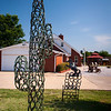 A cactus sculpture formed of welded horseshoes rises at the edge of Longhorn, the Old West town Pat and Belienda Garrett have built on their ranch.