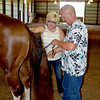 Julie Bushue, left, and Dale Bushue, right, demonstrates how they prepare their horse with a fake tale for competition. Charles Mills photo