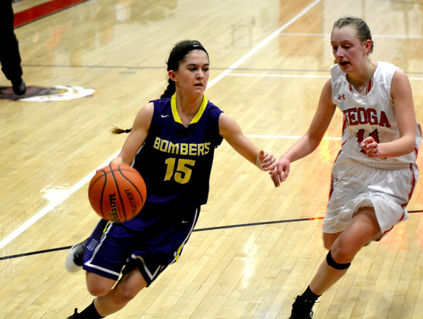 Brownstown/St. Elmo's Claire Wilhour drives past the defense of Neoga's Rachel Ewing. Wilhour had 27 points in double overtime as B/SE won 63-55 on the road.
