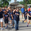 Special Olympian Angie Haarman carries the torch during the the 16th leg of the Special Olympic's Law Enforcement Torch Run started Wednesday morning in downtown Effingham. The event raises awareness and money for the Special Olympics. The state competitions begin on Friday. Graham Milldrum photo
