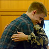Jacob Stoneburner shares an embrace with his mom, Stacy Schuette, who graduated from the Effingham, Fayette, Clay and Jasper Problem-Solving Court on Friday at the Effingham County Government Center. Kaitlin Cordes photo