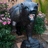 Large as life, a bear sculpted of metal bursts through the roses along the fence of the Newell home.