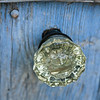 The garden shed at La Ferma sports a touch of elegance in a crystal doorknob on the rustic wood door.