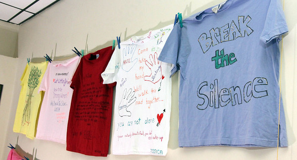 Allegra Boverman/Gloucester Daily Times. Some of the t-shirts that are on display at The Hive as part of The Clothesline Project. October is Domestic Violence Awareness and Prevention Month. T-shirts by victims of violence, friends and family of the victimized and others are also on display at Pathways For Children, and at the Gloucester Family Health Center. There were a grouping on display at the Gloucester Police Station during a ceremony on Tuesday and were on view for an hour afterwards.