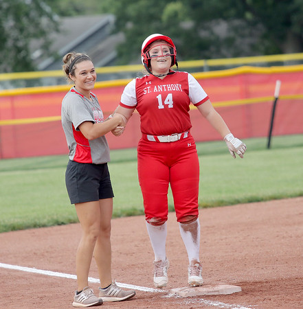 St. Anthony's Alexis Stephens smiles while getting helped up by head coach Makayla Walsh after sliding into third base in the Class 1A Sectional Semifinals against Hutsonville on Tuesday, July 8, 2021, at St. Anthony High School, in Effingham, Illinois. (Alex Wallner/Effingham Daily News)