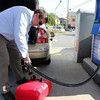 Allegra Boverman/Gloucester Daily Times. Ed  Camuso of Essex fills up gas for his boat at the Richdale Mobil gas station in Essex on Friday after filling up his daughter's Passat.