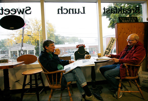 Allegra Boverman/Gloucester Daily Times. Laura and Peter Kemper of State College, Pa., were enjoying some quiet reading and warm beverages at the <br /> Village Market in Essex on Wednesday afternoon. Their next stop was to Dogtown Books in Gloucester to find books on the granite quarries in the area, as they'd visited Halibut Point State Park in Rockport and were intrigued. They were having a getaway to the area this week and were lodging in Rockport.