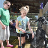 Mandi Donaldson, left, and her daughter Annelise wash off Annelise's Pygmy goats at the Effingham County Fairgrounds. Donaldson said she showed Pygmy goats when she was in 4-H, and this was her daughter's first year showing. Kaitlin Cordes photo.