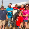 The Niemerg Family stands with one of their dairy cows Wednesday at their farm in Dieterich. Fourth generation dairy farmers Greg and Kelci Niemerg run the farm owned by Greg's parents. Pictured from left to right: Andrew, Greg, Austin, Alicen, Abraham and Kelci Niemerg.<br /> Keith Stewart Photo