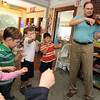 "Allegra Boverman/Gloucester Daily Times. Don Goldenbaum, grandfather of Ruby McElhenny, a student in the Pre-Kindergarden/Kindergarten at Eastern Point Day School, was visiting the school on Thursday morning to talk about being a musician. He is a longtime violinist who performs semi-professionally with three different orchestraa, and is concertmaster at one of them in his hometown of Kansas City. He talked about the kinds of sounds violins can make - happy, sad, fast, slow, high and low. He improvised pieces based on notes that the children asked him to play, and performed such songs as ""The itsy-bitsy spider,"" while they sang along. He also took requests, including playing the theme to ""Star Wars,"" and the theme of its character Darth Vader. He also played ""You are my Sunshine,"" as Ruby sang, and with the whole class, ""The Instrument Song,"" while the class performed on imaginery instruments and marched around the room. From left are Harley White, Adam Conigliari, Marin Franzel, Aidan Woods and Kameron Francis."