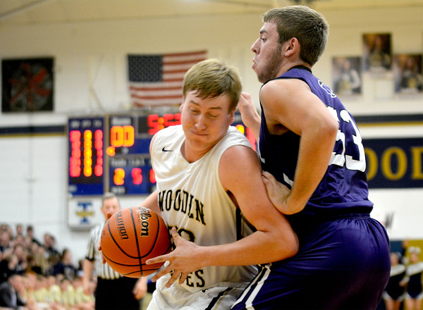 Teutopolis' Lane Belleville muscles around the defense of Breese Central's Joe Ratermann in the post.