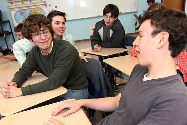 Allegra Boverman/Gloucester Daily Times. From back to front are Nate Allen, Quenton Hurst, Corey Silver and Oliver Herman, along with ( ) at upper right, trying to answer some tough quiz questions on Tuesday at Rockport High School.