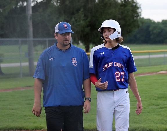 Shelby County Senior Legion head coach Terry Coleman (left) and Hayden Koonce (right) talk after walking off the field at the end of an inning during a legion baseball game against Lincoln Post 263 on Tuesday, June 29, 2021, at Shelbyville High School, in Shelbyville, Illinois.