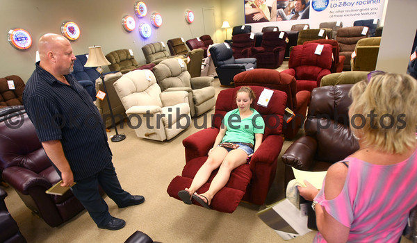 5-24-12<br /> Robert Miller & Sons Furniture opening in the Kokomo Mall or what is now called the Kokomo Town Center. Salesman Alen Lawson works with Nichole Dennis and her mom, Jill Lawson, with picking a recliner at the new store.<br /> KT photo | Tim Bath