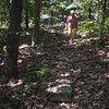 Trudy Sudberry makes her way down one of the paths she and her husband, <br /> B.P. Sudberry, have made on the hill behind the cottage.