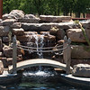 A small bridge spans the waterfall that tumbles into the free-form pool in the backyard of the Garrett home.
