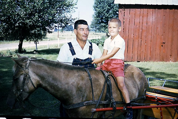 A young Philip eonard with his grandpa, Jewel Leonard, at the family farm in Ingraham circa 1963.<br /> Submitted by Kathy Leonard
