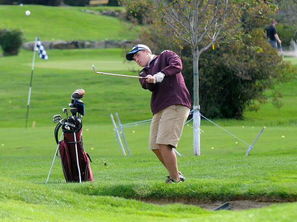Jim Vaiknoras/Gloucester Daily Times: Rockport's Kyle Nelson chips on the green at the first hole during they teams match against Newburyport at Rockport Country Club Monday.